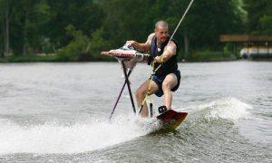 extreme ironing while surfing