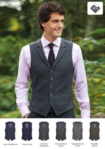 Gilet da divisa elegante in lana e poliestere e finiture in teflon. Ideale per uniformi di portierato, hotel, receptionist.