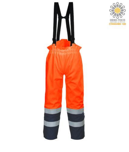 Pantalone antistatico, ignifugo ad alta visiblità, bretelle regolabili con fibbia, doppia banda su fondo gamba, bicolore, certificato EN 343:2008, UNI EN 20471:2013, EN 1149-5, EN 13034, UNI EN ISO 14116:2008, colore arancione